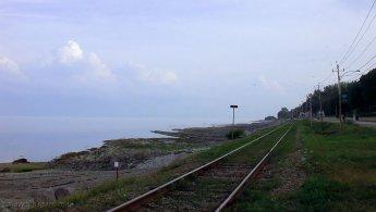 Railroad near the misty St-Lawrence River desktop wallpapers